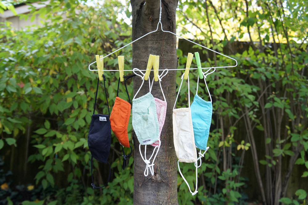 A set of masks drying on a homemade mask drying rack