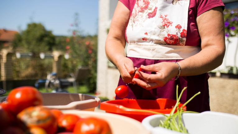 Preparing homemade tomato sauce outdoors