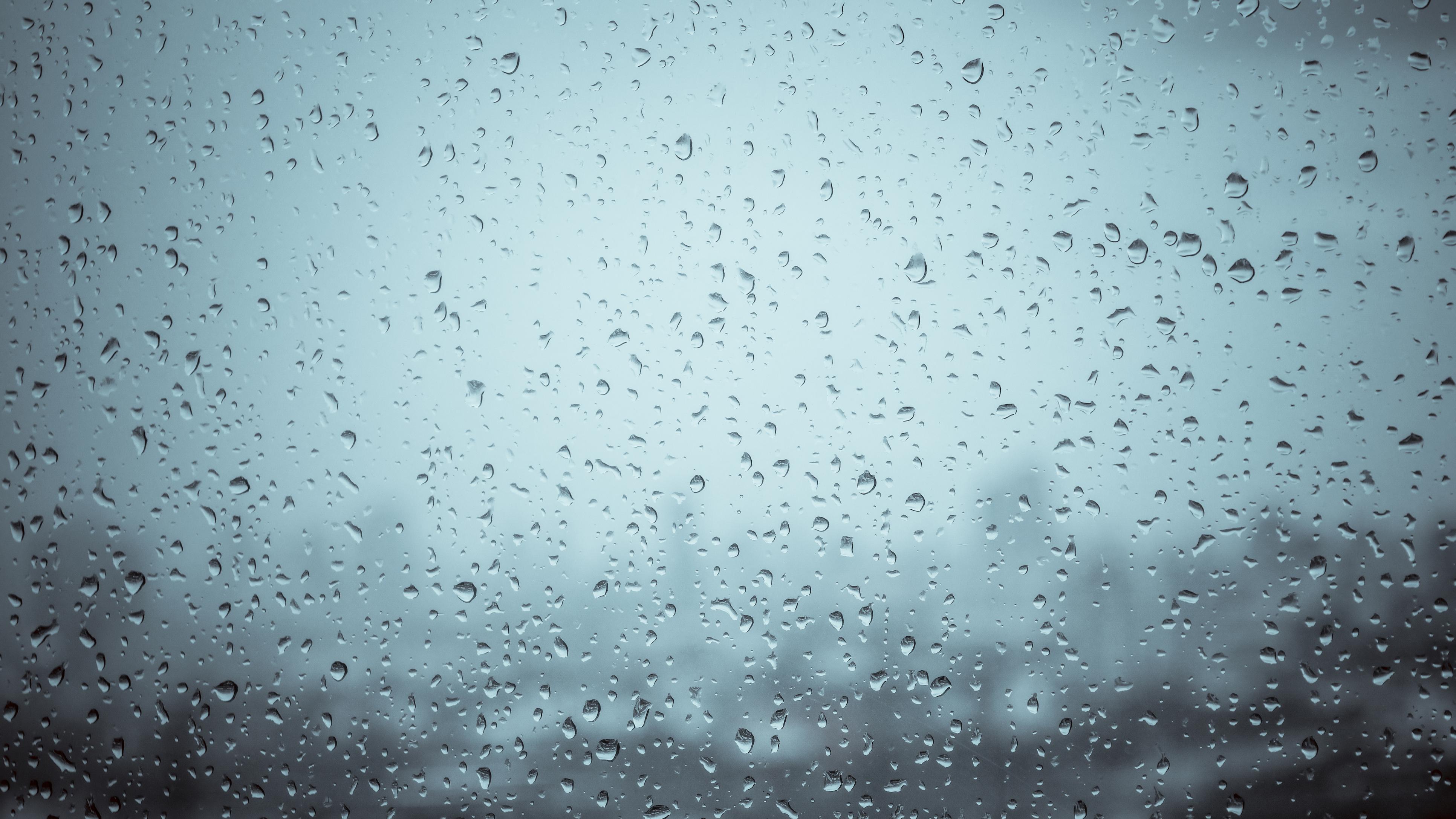 Raindrops on a window on a gloomy day to illustrate an FAQ on seasonal affective disorder (SAD)