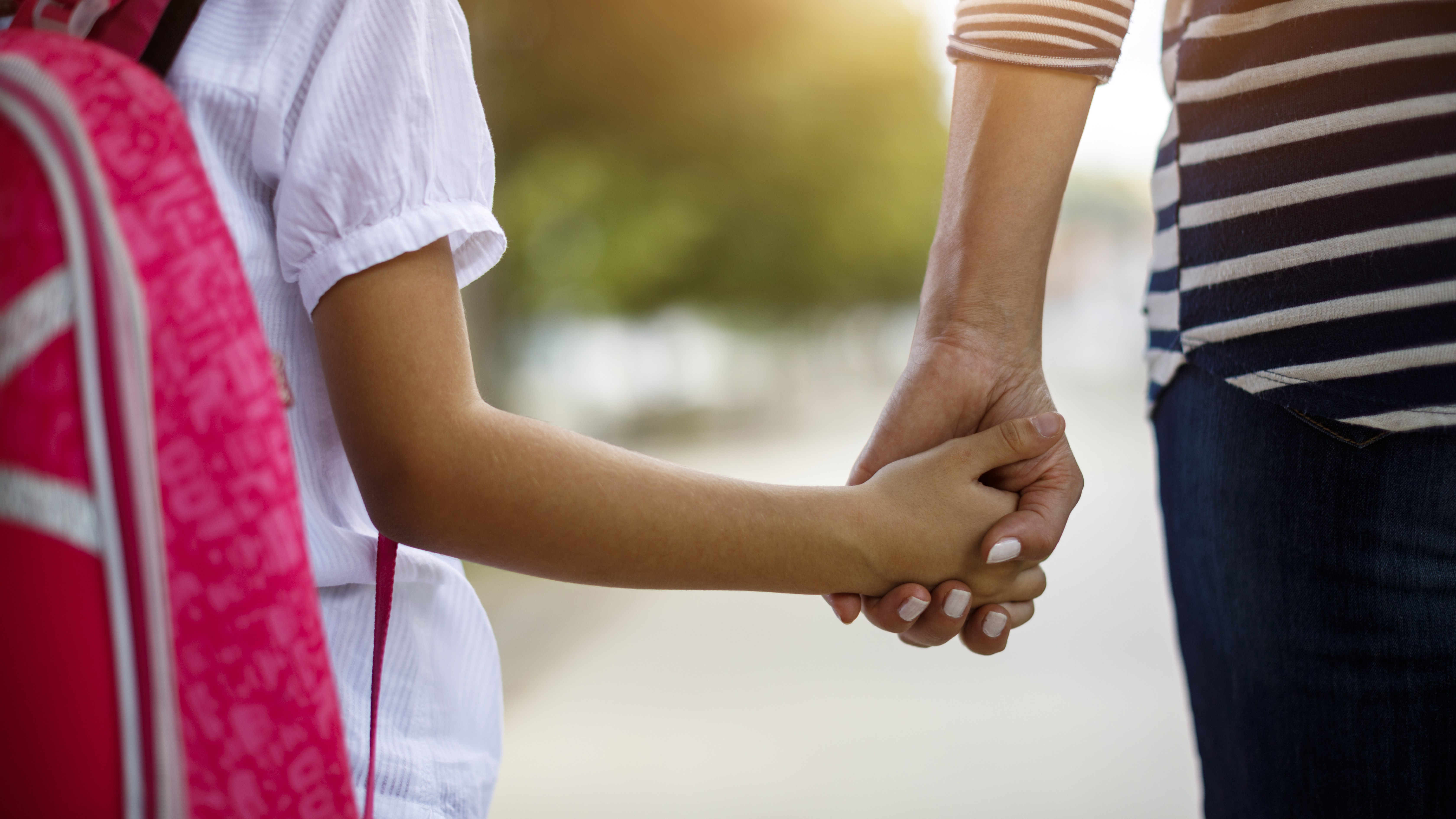 A mother and daughter holding hands to illustrate a piece on parenting through an anxiety disorder