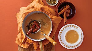 Masala Chai tea in pot with loose spices