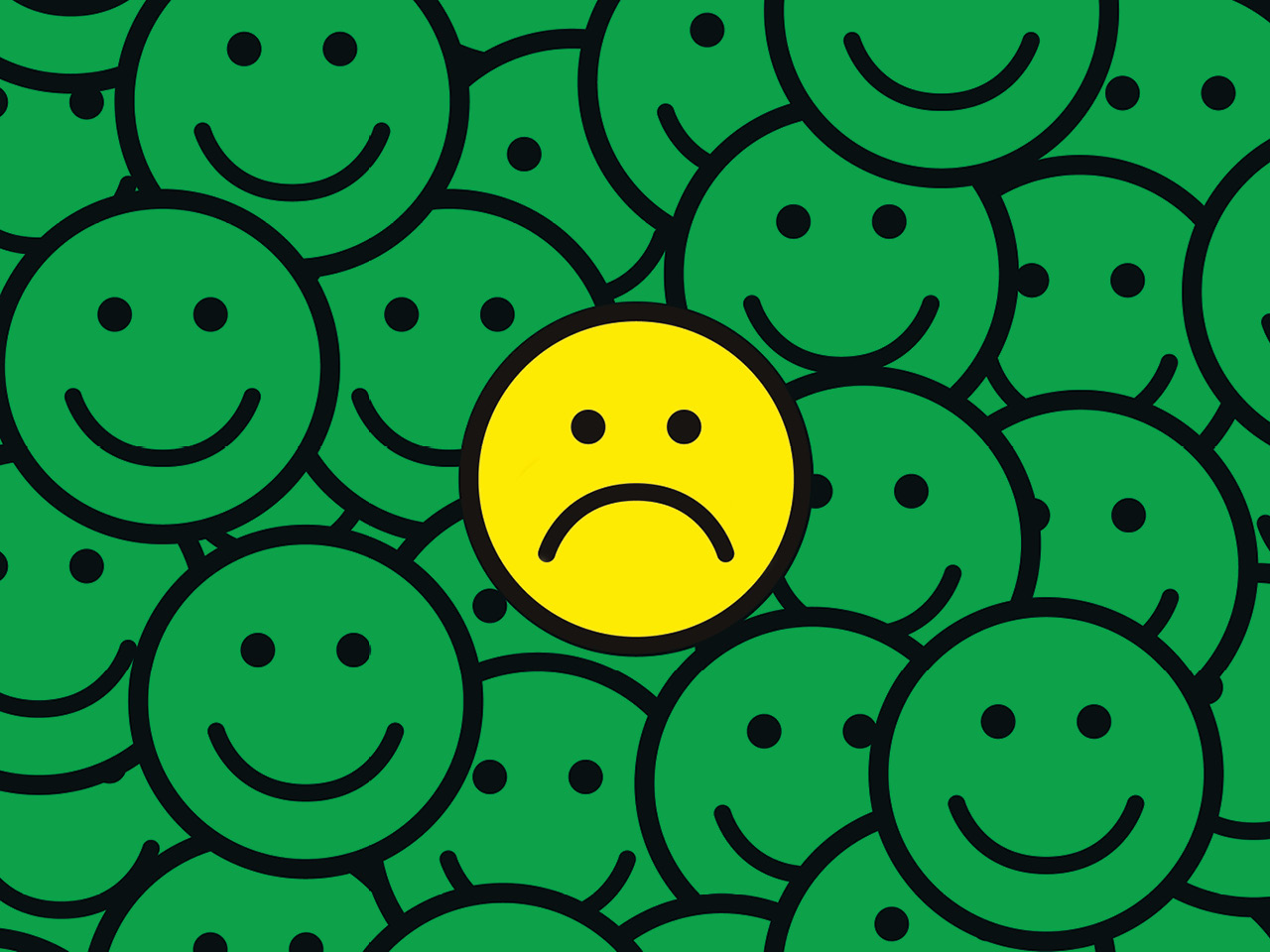 An illustration of one sad face in a pile of happy faces.