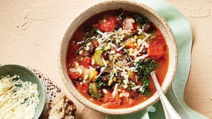 Instant Pot Barley Minestrone Soup in beige bowl with spoon
