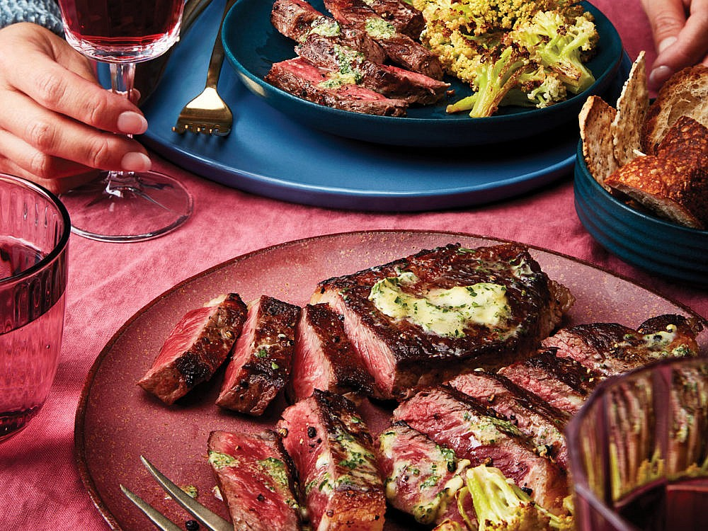 Steak with Garlic-Herb Butter and Roasted Parmesan Caulilini
