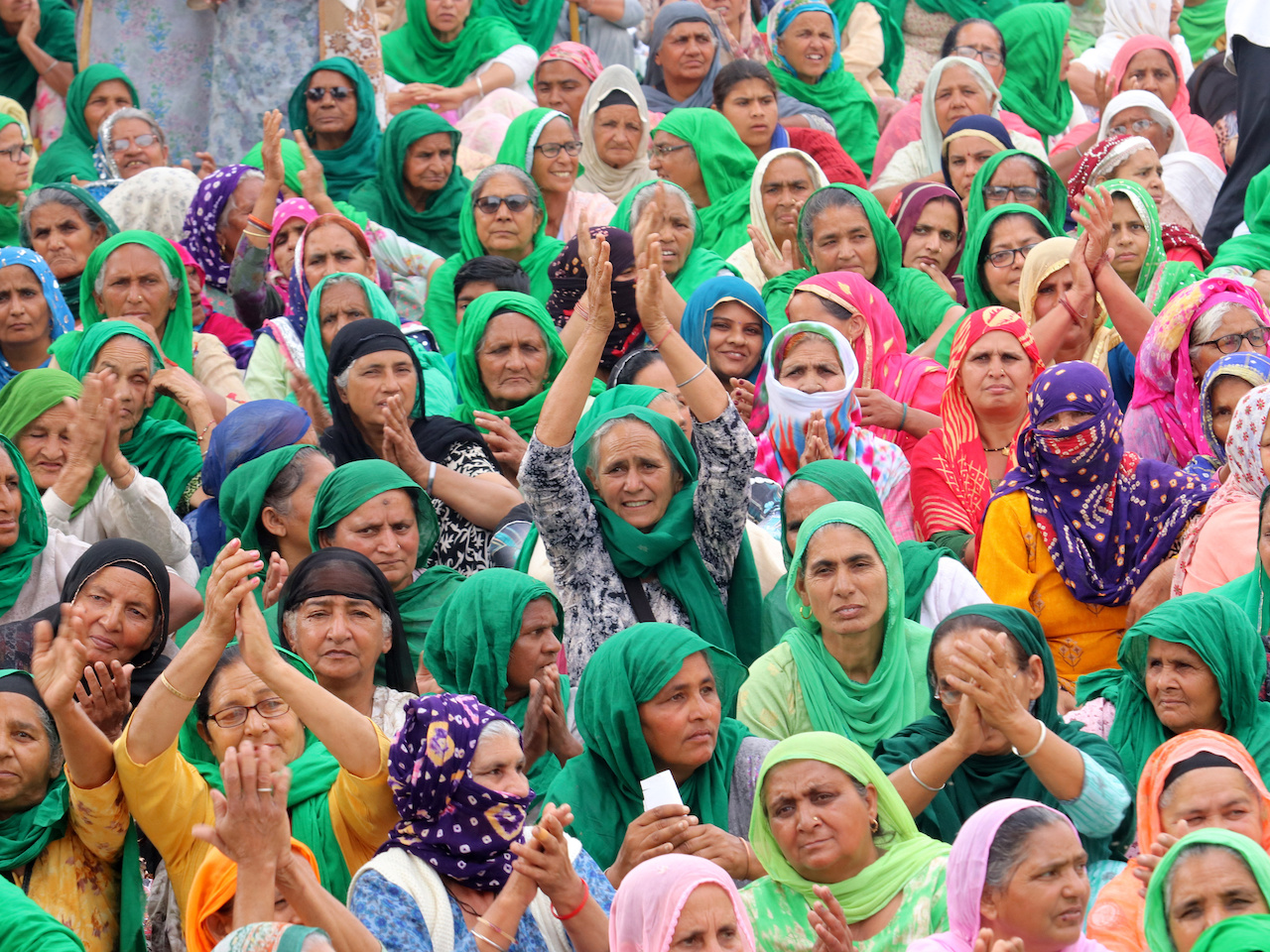 A photo of Indian women farmers from Haryana and Punjab clapping their hands on International Women's Day, during ongoing protests against new agricultural laws.