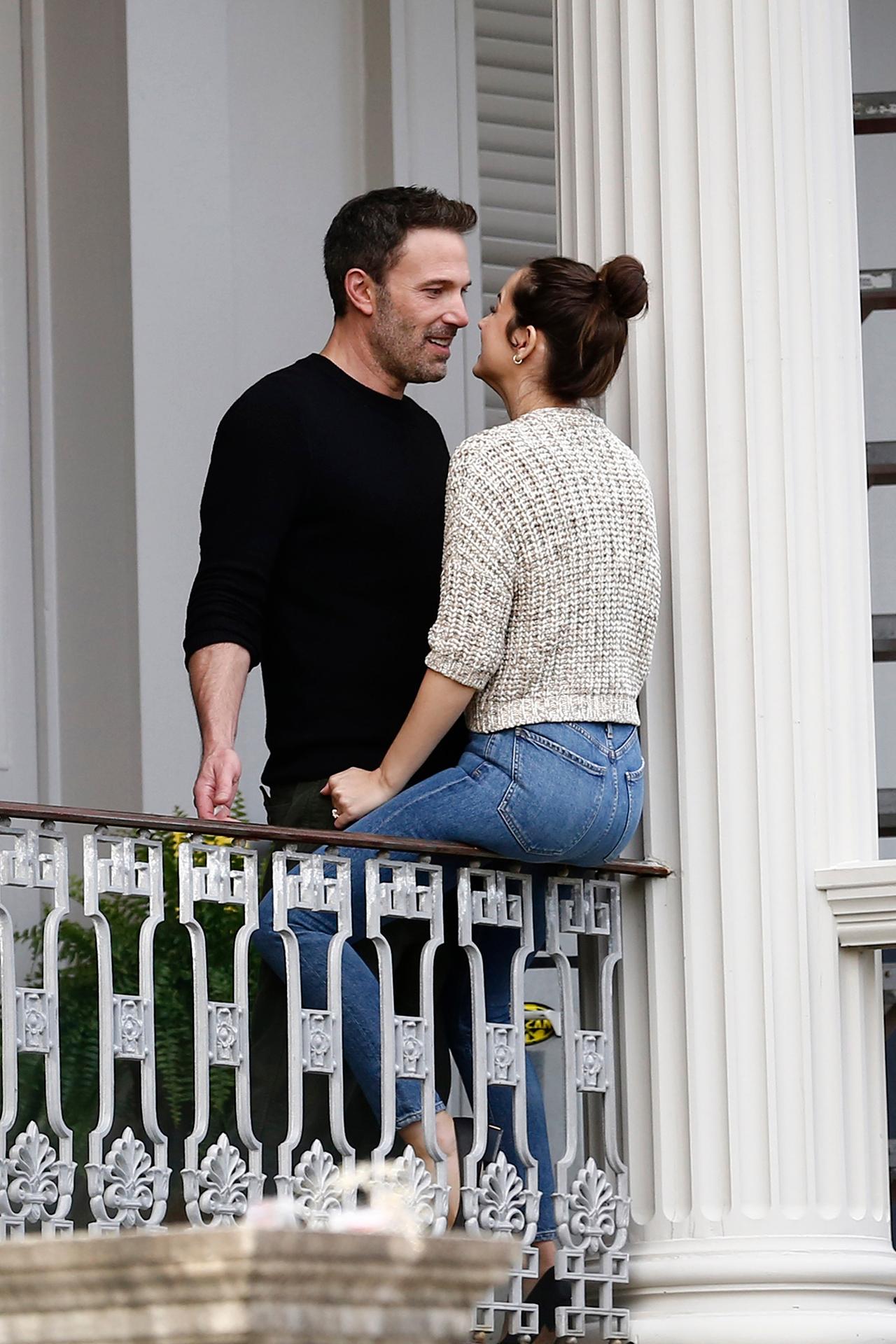 Ben Affleck and Ana de Armas kissing on a balcony