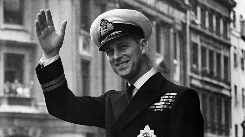 Prince Philip, Duke Of Edinburgh, waving from a car in 1948. (Central Press/Getty Images)