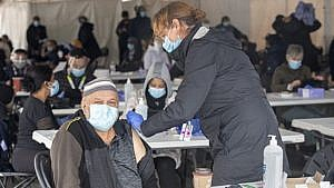 Man gets vaccinated at pop-up clinic