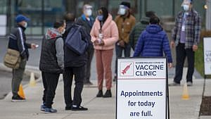 Visitors arrive at a pop up COVID-19 vaccine clinic at David and Mary Thomson high school in Toronto on Thursday, April 29, 2021. Hundreds of people lined up through the night in the hard hit community. THE CANADIAN PRESS/Frank Gunn