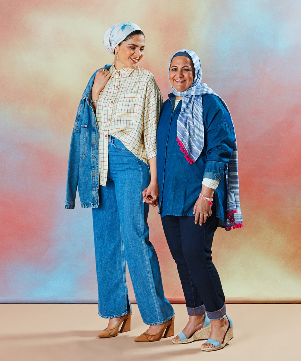Two women wearing double denim for an article on spring 2021 fashion trends.