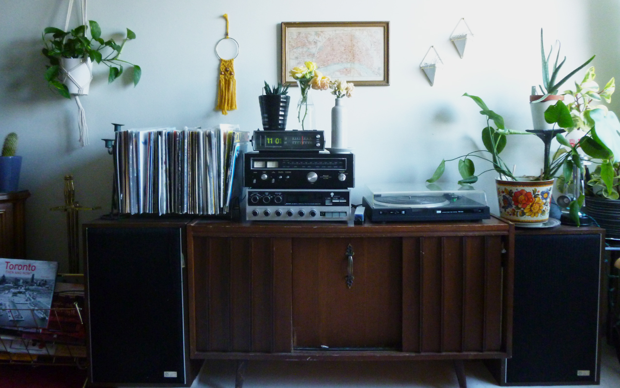 A vintage credenza in an apartment furnished for free through curbing