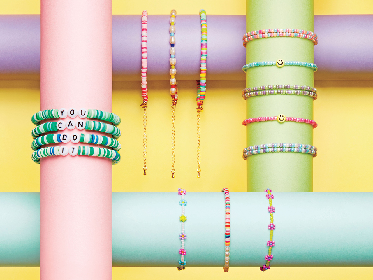 Colourful stacks of summer-camp-inspired jewellery.