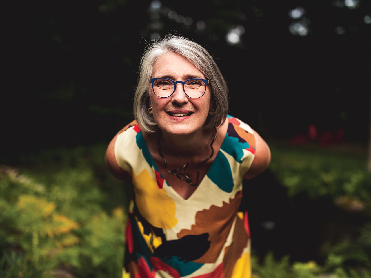 A portrait of crime writer Louise Penny leaning into the camera