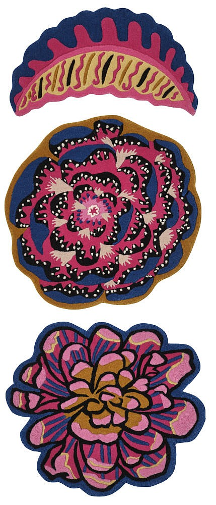 Three differently shaped asymmetrical rugs with multicoloured designs.