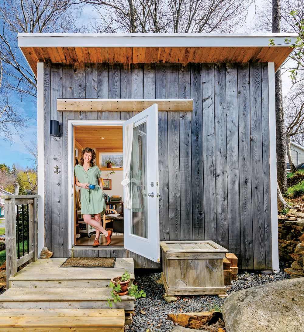 Writer Michelle Elrick standing in the doorway of her Nova Scotia backyard shed office.