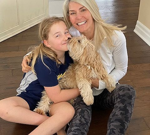 Mary-Alice Vuicic and daughter with dog