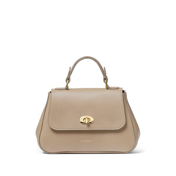 A photo of the bag. Kate carried an on-trend mini bag. She rounded out her look with the Mini Holly in Taupe Atlantic by Tusting