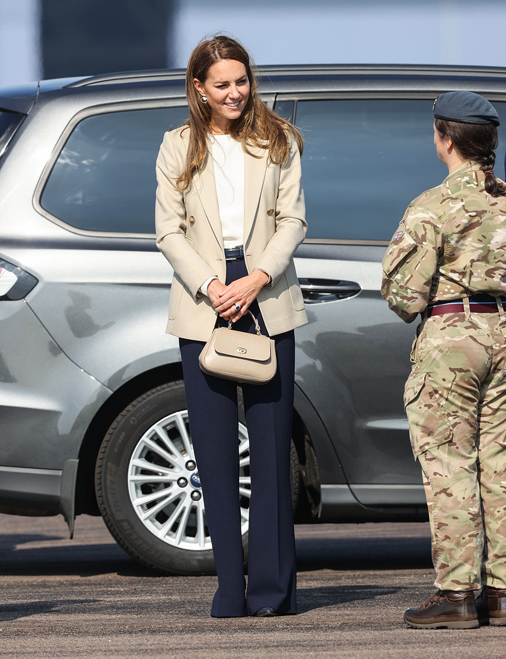BRIZE NORTON, ENGLAND - SEPTEMBER 15: Catherine, Duchess of Cambridge arrives to meet those who supported the UK's evacuation of civilians from Afghanistan, at RAF Brize Norton on September 15, 2021 in Brize Norton, England. Operation PITTING, the largest humanitarian aid operation for over 70 years, ran between 14th and 28th August, where in excess of 15,000 people were flown out of Kabul by the Royal Air Force. (Photo by Chris Jackson/Getty Images)