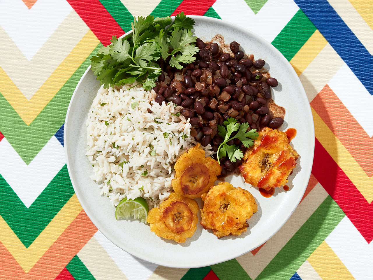 Smashed Plantains With Beans and Rice